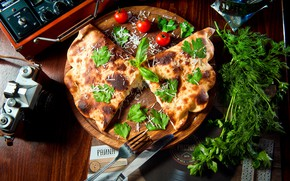 Picture greens, tomatoes, calzone