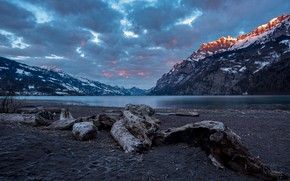 Picture the sky, clouds, snow, sunset, mountains, clouds, lake, rocks, shore, Switzerland, driftwood, Walensee, Walenstadt