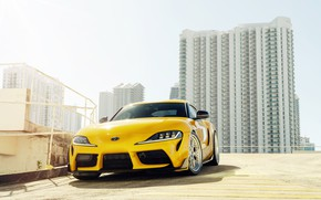 Picture yellow, building, sports car, front view, Toyota Supra, 2020 Toyota GR Above