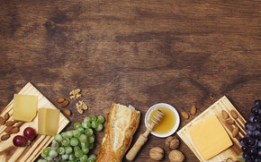 Picture cheese, bread, grapes, nuts, honey, baguette
