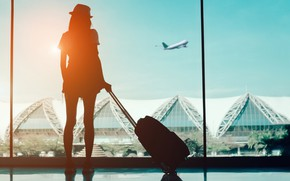 Picture girl, the plane, airport, suitcase