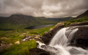 Picture grass, clouds, mountains, clouds, fog, lake, stream, stones, hills, shore, waterfall, stream, gloomy sky