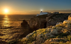 Picture the sun, light, sunset, flowers, stones, rocks, lighthouse, the evening, yellow, burning