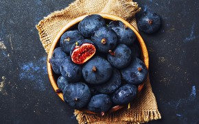 Picture the dark background, bowl, fruit, burlap, figs