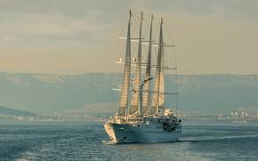 Picture the sky, shore, ship, sailboat