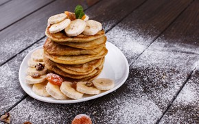 Picture bananas, wood, cakes, nuts, powdered sugar, raisins, pancakes, mint, bananas, dried apricots, puncakes