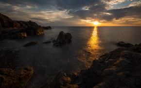 Picture sea, clouds, rays, sunset, pebbles, stones, rocks, shore, coast, twilight