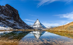 Picture the sky, water, the sun, snow, mountains, lake, reflection, people, rocks, Switzerland
