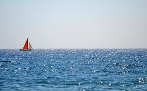 Picture the ocean, boat, horizon, sails, reflections, Red sail boat floating in ocean