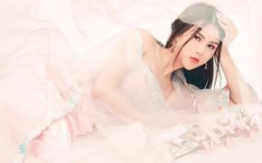 Picture look, girl, flowers, pose, background, pink, ease, tenderness, portrait, bouquet, earrings, hands, silk, dress, brunette, ...