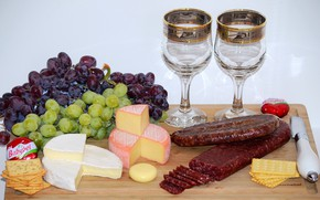 Picture table, cheese, glasses, grapes, knife, sausage, bokeh