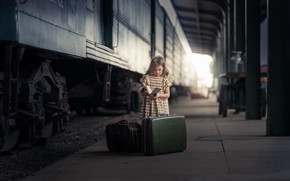 Picture station, girl, book, suitcases