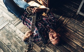 Picture guitar, jeans, shirt, guy, on the floor, Rome Rome