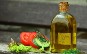Picture greens, bottle, oil, tomatoes, cucumbers