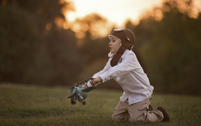 Picture grass, nature, the game, boy, child, airplane, Larisa Korsikova