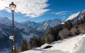 Picture winter, forest, the sky, the sun, clouds, snow, trees, mountains, rocks, post, Switzerland, slope, lantern, …