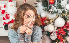 Picture girl, joy, pose, smile, mood, holiday, toys, new year, portrait, lollipops, tree, brown hair, Santa …