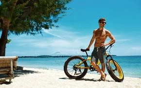 Picture sand, sea, beach, summer, the sky, the sun, trees, bike, pose, shorts, figure, horizon, glasses, …