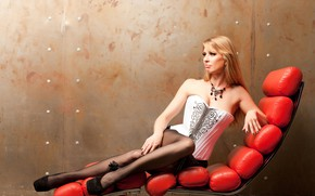 Picture girl, background, wall, skirt, necklace, makeup, figure, hairstyle, blonde, shoes, corset, legs, sunbed, posing