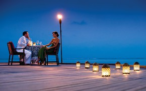 Picture the ocean, wine, romance, the evening, lights, pair, two, dinner