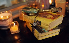 Picture magnifying glass, pocket watch, candles, table, clock, Books, miscellanea