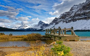 Picture forest, the sky, grass, the sun, clouds, snow, trees, mountains, lake, rocks, shore, Canada, the …