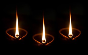 Picture fire, candles, light and darkness, Happy Diwali