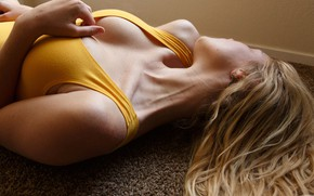 Picture sexy, pose, wall, model, carpet, Mike, hairstyle, blonde, lies, on the floor, in yellow, Zishy