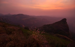 Picture the sky, grass, clouds, sunset, mountains, fog, hills, height, plants, the evening, slope, top, twilight