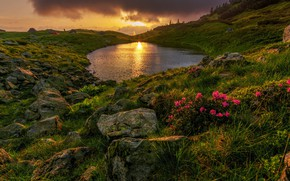Picture the sun, pond, stones, hills