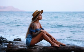 Picture sea, girl, pose, mood, shorts, hat, tattoo, log, long hair, Denis Lankin, Valeria Radkovskiy