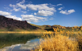Picture the sky, clouds, light, mountains, lake, reflection, blue, hills, shore, the slopes, reed, pond