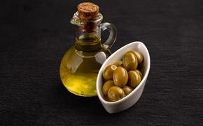 Picture glass, the dark background, bowl, olives, bottle, olive oil