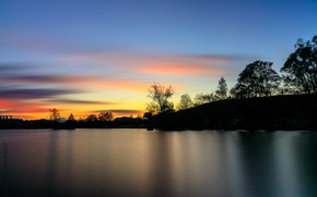 Picture the sky, trees, sunset, river, shore, silhouettes