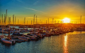 Picture the sky, water, the sun, rays, light, sunset, bright, the city, lights, hills, shore, boats, …