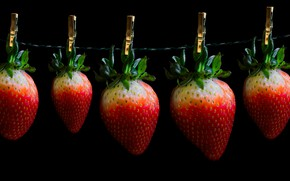 Picture berries, strawberry, black background, clothespins