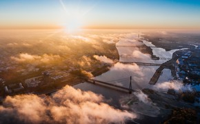 Picture the sky, the sun, clouds, rays, sunset, the city, river, height, home