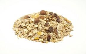 Picture white background, hazelnuts, raisins, muesli