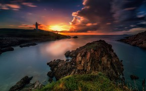 Picture sea, clouds, sunset, stones, rocks, shore, lighthouse, bright colors