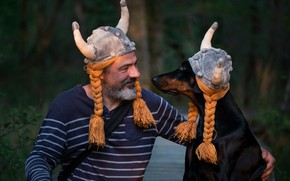Picture look, smile, the dark background, each, mood, together, hat, dog, friendship, pair, horns, helmet, profile, …