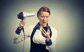 Picture pose, background, woman, makeup, hairstyle, costume, blouse, brown hair, is, grimace, dissatisfaction, keeps, smartphone, Hairdryer