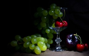Picture the dark background, glass, grapes, fabric, fruit, still life, cherry, figs