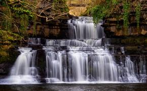 Picture the dark background, rocks, waterfall, stream, cascade