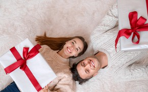 Picture girl, love, joy, Christmas, gifts, New year, male, bow, on the floor, smile, New Year