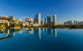 Picture the sky, water, the sun, trees, reflection, building, home, pool, skyscrapers, Philippines, Makati