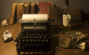 Picture books, bottle, alcohol, typewriter, still life, butts