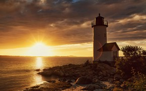 Picture sea, the sun, clouds, rays, light, sunset, clouds, stones, dawn, shore, lighthouse, horizon, the bushes