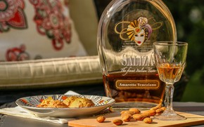 Picture glass, bottle, cookies, almonds