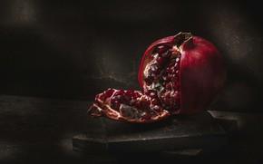 Picture the dark background, table, fruit, still life, bars, garnet, composition, pomegranate grains