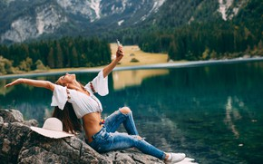 Picture forest, girl, landscape, mountains, nature, pose, smile, lake, shore, jeans, hat, makeup, figure, hairstyle, brown …